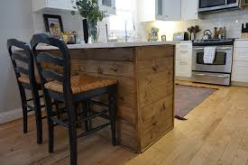ikea kitchen peninsula making it ours dahlias and dimes she wanted two things 1 natural wood accents 2 a feature that really states this kitchen is ours so i was the labor and the faux shiplap peninsula