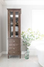 bathroom linen cabinet with glass doors restoration hardware maison tall bath cabinet in master bathroom
