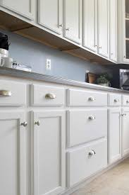 how to paint kitchen door knobs how to paint cabinets with a sprayer craving some creativity