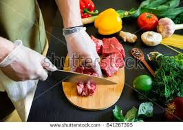 meat cutting table tops cook cutting meat on board fresh stock photo 641267395 shutterstock
