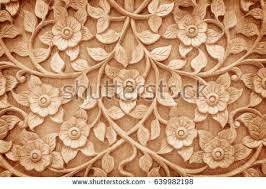 pattern flower carved on wood background stock photo 639982198