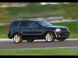 2010 jeep grand cherokee srt8 front and side speed 1920x1440
