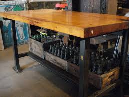antique butcher block table with metal base and lower shelf via