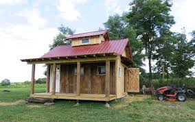 8 pole structure with porch and cupola recycled barn wood used on