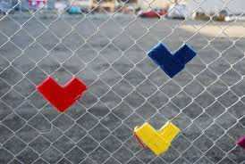 Fence Decorations Making Colorful Hearts Decorations On Wire Fence Simple Craft