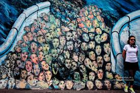 the murals on berlin wall s east side gallery traveling solemates arts paintings on berlin wall s east side gallery