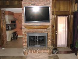 rustic exposed brick fireplace mantle with wall mount tv and f