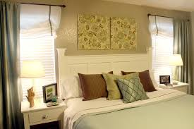 Bedroom Decorating Ideas No Headboard White Bedding Set Plus Brown And Stripped Cushions Placed In The
