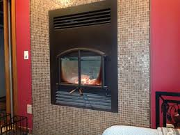 High Efficiency Fireplaces by High Efficiency Wood Burning Fireplace With Glass Tiles Hauser