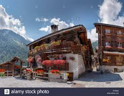ancient traditional wooden houses chalet town village flowers