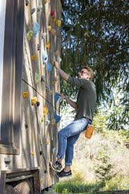 tiny heirloom clads mobile home with rock climbing wall