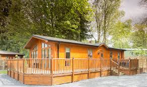 Holiday Cottages In The Lakes District by Oakwood Lodge Holiday Log Cabin With Tub In The Lake District