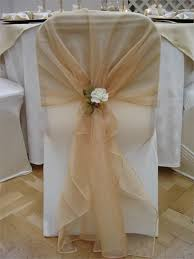 chair bows for weddings ivory chair cover with gold organza sash and ivory tieback