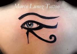 beautiful horus eye tattoo on upper back