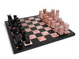 hand carved pink and black quartz chess set with chess board