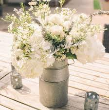 wedding flowers rustic milk churns for the rustic wedding flowers the flower monger