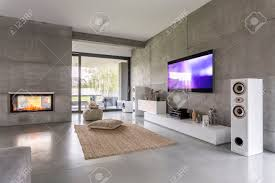 Livingroom Fireplace by Tv Living Room With Window Fireplace And Concrete Wall Effect