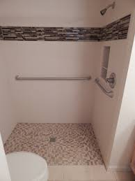 this zero barrier custom shower features a corian wall surround
