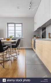 exclusive and modern designed kitchen with table and black chairs