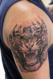 roaring tiger arm in black and gray by jesus