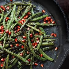 charred green beans with garlic and pomegranate seeds thefeedfeed