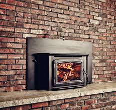 living room black polished brass gas fireplace insert with fire