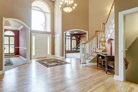 Wood Banister Traditional Entryway With Chandelier U0026 Arched Window In Wildwood