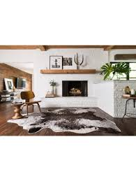 interior dazzling living room decor with cowhide rugs and white