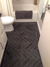 charcoal gray herringbone honed marble floors in the bathroom