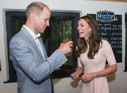 kate middleton turns barmaid as she pours prince william a pint of