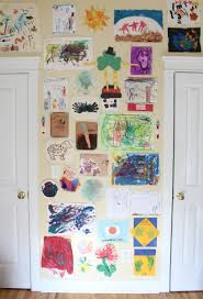 kids artwork gallery wall using glue dots and washi tape simple