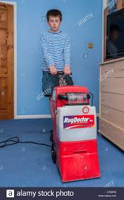 Rug Doctor Carpet Cleaning Machine A Boy Cleaning His Bedroom Carpet With A Hired Rugdoctor Carpet
