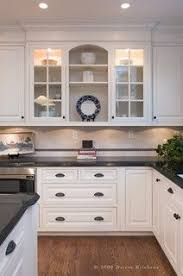 white kitchen cabinets with glass cup pulls kitchens llc black kitchen countertops neat