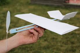 how to make a rubber band plane out of paper very easy youtube