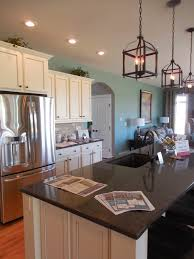 2014 s parade of homes in central new york and who doesn t fall in love with white kitchen cabinetry i loved the lanterns above the kitchen island and the stenciled wall in one