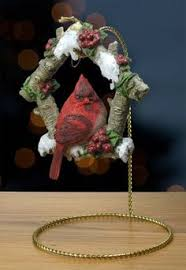 cardinal figurine ornament and brass ornament stand