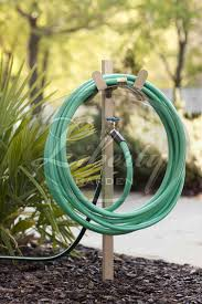 10 best practical and pretty garden hose hangers images on