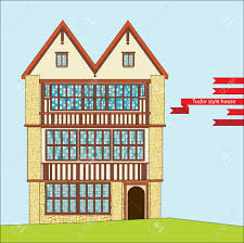 three story tudor style house with large windows royalty free