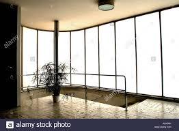 a translucent wall originally of opaque glass lights the entry