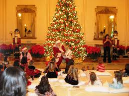planning a christmas party with santa reading to the kids san