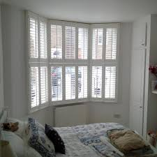 bay window tier on tier shutters bramley blinds and awnings