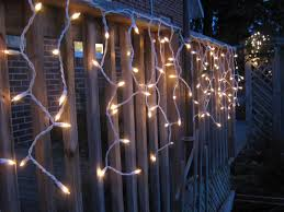 decorating inspiring led icicle lights with wooden fence and