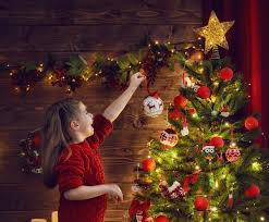 decorating christmas tree girl decorating christmas tree stock photo christmas stock photo