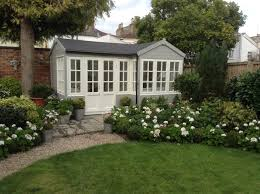the summerhouse exterior walls painted in a 50 50 mix of cuprinol