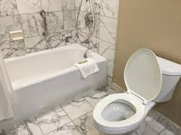 Bathroom Looks Marble Design Of Flooring And Wall Tiles In Bathroom Looks Elegant