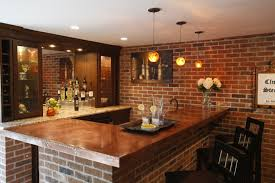 basement with exposed brick copper countertops mirrored