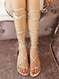 withchic golden knee high strappy lace up zipper gladiator sandals