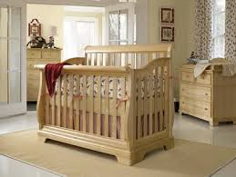 a young america built to grow sleigh crib in a natural wood stain