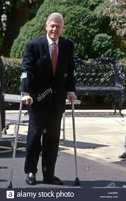 president bill clinton on crutches at the white house in