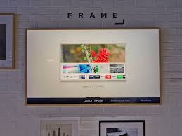 tech wall art samsung frame tv doubles as artwork hands on photos business